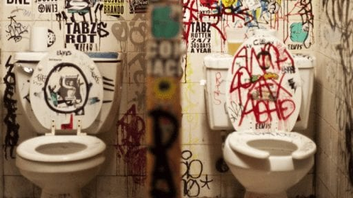 Toilet stall with graffiti
